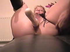 Whore plays with her dildo's