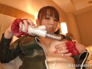 leather clad race queen plays with her sex toy