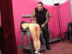 Horny master puts his slave on his lap and spanks her