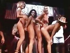 CMNF girls on stage showing all their assets in this film clip