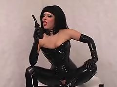 Babe in hot latex outfit fucks herself to orgasm