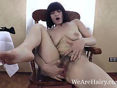 Alina H undresses and masturbates on wooden chair