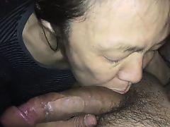 Asian MILF sucking a white rod