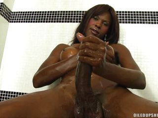 sexy tranny strokes her big black dong in the shower