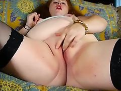 Super sexy chubby redhead loves to play with her juicy pussy