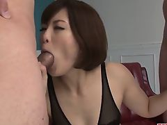 Tomoka Sakurai appears to be sucking on two cocks