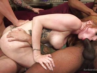 busty redhead versus four huge dicks