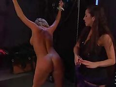 Busty blonde is tied up and tortured by her lesbian masters