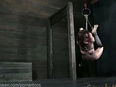 Bondage chick endures face fucking & suspension