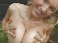 Busty girl fucks in the garden
