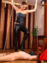 Leashed boy gets decent spanking before being allowed to lick domme's pussy