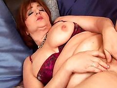Chubby brunette mature with big tits is toying