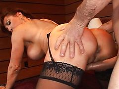 Redhead MILF gets a rough anal pounding